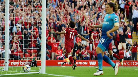 Selebrasi Mohamed Salah usai cetak gol ke gawang Arsenal. - INDOSPORT