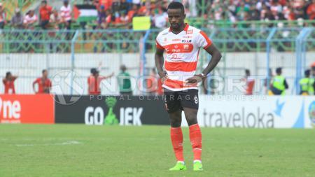 Penyerang Madura United, Greg Nwokolo. - INDOSPORT