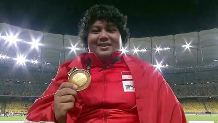 Eki Febri Ekawati, berhasil sumbang medali emas di cabor tolak peluru putri di SEA Games 2017. - INDOSPORT