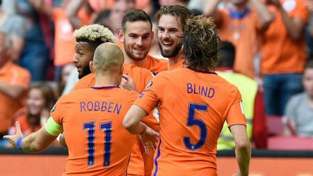 Selebrasi para pemain Belanda usai mencetak gol. - INDOSPORT