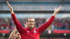 Indosport - Bintang klub Liga Spanyol, Gareth Bale saat memperkuat Timnas Wales.