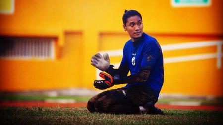 Sandy Firmansyah, kiper Sriwijaya FC. - INDOSPORT