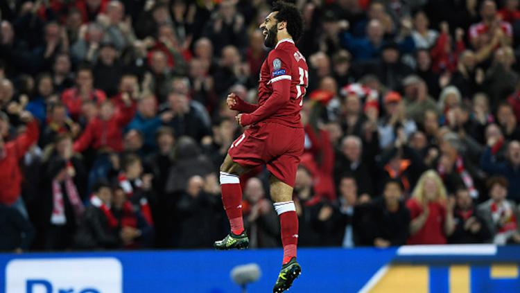 Selebrasi pemain bintang Lvierpool, Mohamed Salah usai cetak gol ke gawang Sevilla. Copyright: INDOSPORT
