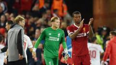 Indosport - Georginio Wijnaldum tepuk tangan usai pertandingan melawan Sevilla.