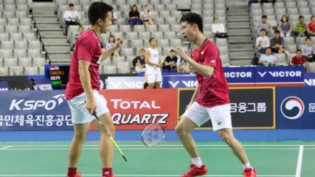 Kevin Sanjaya Sukamuljo/Marcus Fernaldi Gideon selebrasi usai lolos ke semifinal Korea Open 2017. - INDOSPORT