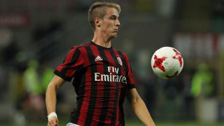 Andrea Conti, bek kanan AC Milan. - INDOSPORT