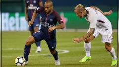 Indosport - Lucas Moura (kiri) gelandang serang PSG.