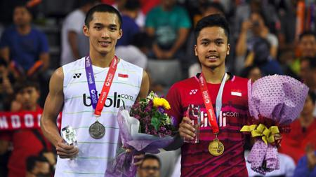 Wakil tunggal Indonesia, Anthony Sinisuka Ginting  Jonatan Christie, jadi lawan yang patut diwaspadai oleh pelatih China, Chen Yu di Olimpiade 2021 mendatang. - INDOSPORT
