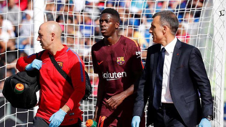 Ousmane Dembele saat alami cedera. Copyright: Reuters