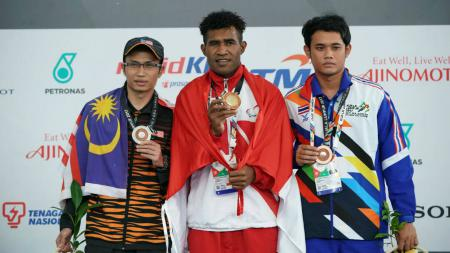 Marinus Malianus memenangkan emas renang gaya dada 50 m. - INDOSPORT