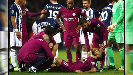 Ilkay Gundogan (Manchester City) mengalami cedera saat timnya melawan West Bromwich Albion di kancah Piala Liga Inggris. - INDOSPORT