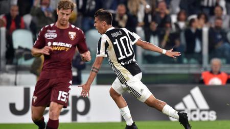 Selebrasi Dybala usai mencetak gol ke gawang Torino. - INDOSPORT