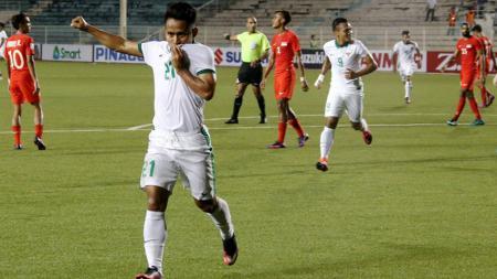 Andik Vermansah saat selebrasi gol ke gawang Singapura pada Piala AFF 2016. - INDOSPORT