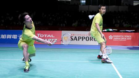 Aksi Kevin/Marcus di laga final Japan Open Super Series 2017. - INDOSPORT