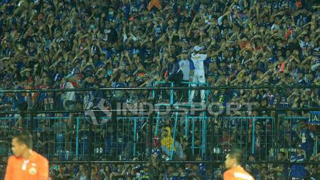 Aremania, pendukung setia Arema FC. - INDOSPORT