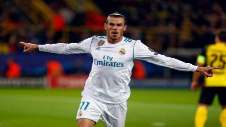 Gareth Bale merayakan gol pada pertandingan Grup H Liga Champions melawan Borussia Dortmund di Signal Iduna Park. - INDOSPORT