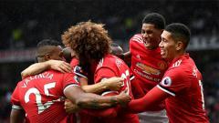 Indosport - Para pemain Manchester United lakukan selebrasi.