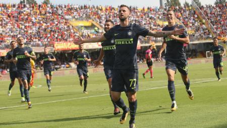 Pemain Inter Milan melakukan selebrasi. - INDOSPORT