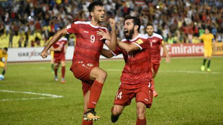 Omar Al Somah melakukan selebrasi pasca mencetak gol penyama kedudukan. - INDOSPORT