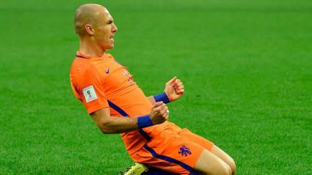 Arjen Robben melakukan selebrasi pasca mencetak gol. - INDOSPORT
