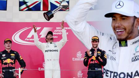 Lewis Hamilton berhasil memimpin finis di GP Jepang. - INDOSPORT