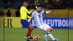 Indosport - Lionel Messi (kanan).