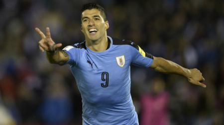 Luis Suarez kala membela Timnas Uruguay. - INDOSPORT