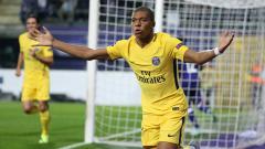 Indosport - Kylian Mbappe berselebrasi usai cetak gol.
