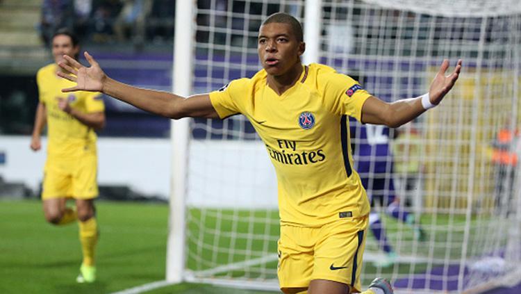Kylian Mbappe berselebrasi usai cetak gol. Copyright: INDOSPORT