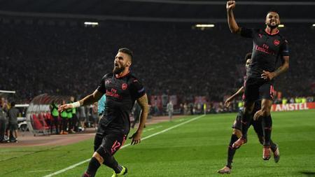 Olivier Giroud dan Theo Walcott merayakan gol. - INDOSPORT