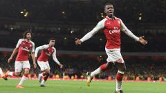 Indosport - Eddie Nketiah melakukan selebrasi usai cetak gol ke gawang Norwich.