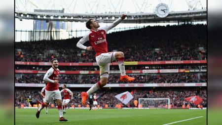 Selebrasi pemain Arsenal, Aaron Ramsey saat memberikan kemenangan untuk Arsenal. - INDOSPORT