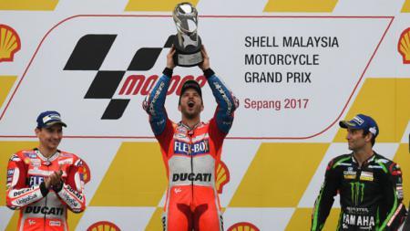 Andrea Dovizioso berhasil menjadi yang pertama di balapan GP Sepang. - INDOSPORT