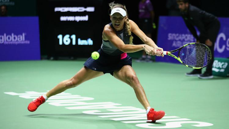 Caroline Wozniacki sukses menumbangkan Venus Williams. Copyright: INDOSPORT