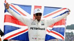 Indosport - Lewis Hamilton saat dipastikan jadi juara dunia 2017 di GP Meksiko.
