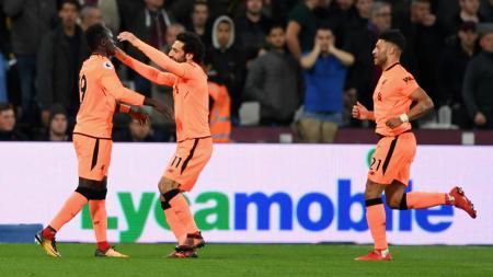 Selebrasi Mohamed Salah kala membawa Liverpool unggul atas West Ham United. - INDOSPORT