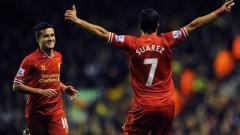 Indosport - Luis Suarez dan Philippe Coutinho saat membela Liverpool.
