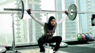 Atlet Angkat Besi, Amna Al Haddad - INDOSPORT