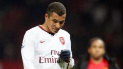 Indosport - Gilberto Silva saat masih berseragam Arsenal.
