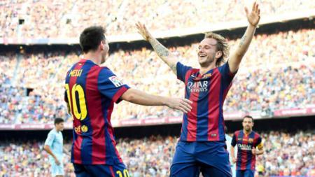 Lionel Messi dan Ivan Rakitic. - INDOSPORT