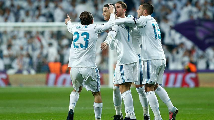 Skuat Real Madrid merayakan gol Ronaldo ke gawang Dortmund. Copyright: INDOSPORT