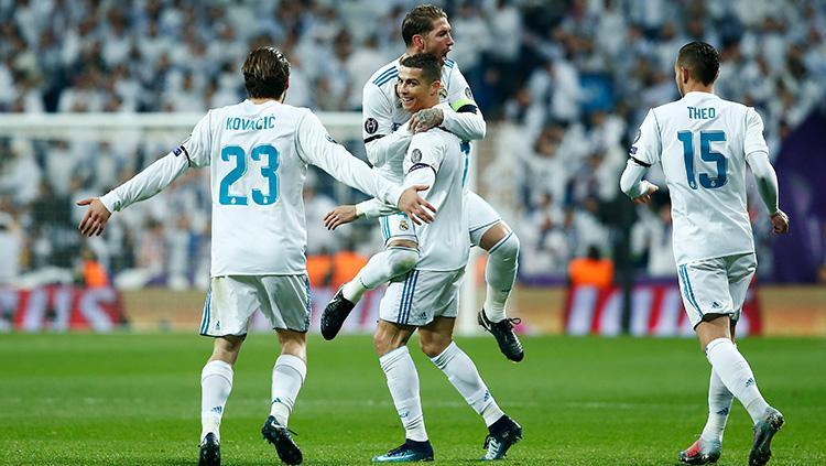 Cristiano Ronaldo merayakan gol bersama rekan satu timnya. Copyright: INDOSPORT