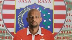 Indosport - Ilustrasi Felipe Melo mengenakan jersey Persija Jakarta.