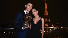 Indosport - Cristiano Ronaldo dan kekasihnya Georgina Rodriguez.