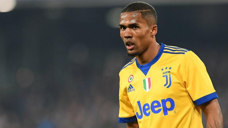 Douglas Costa, pemain Juventus. Copyright: INDOSPORT