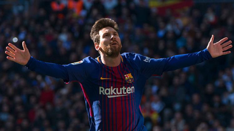 Lionel Messi merayakan selebrasinya pasca mencetak gol ke gawang Real Madrid. Copyright: INDOSPORT