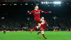Indosport - Aksi Coutinho usai menjebol gawang Swansea City.