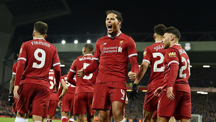 Virgil van Dijk usai merayan gol debutnya bersama Liverpool Copyright: INDOSPORT