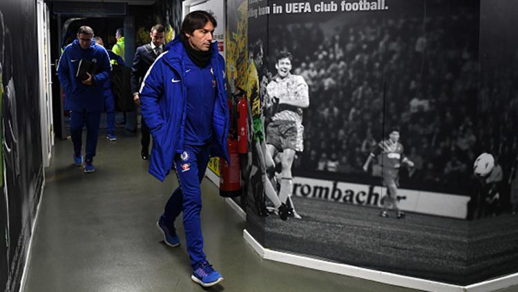 Antonio Conte saat masuk ke lorong stadion. Copyright: INDOSPORT