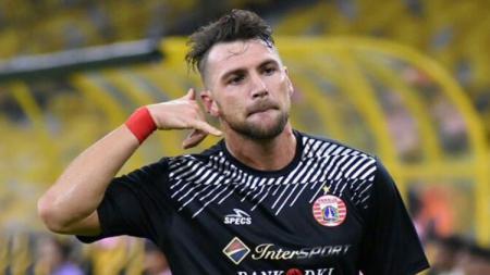 Marko Simic melakukan selebrasi usai mencetak gol pertama. - INDOSPORT